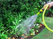 Use a hose nozzle to conserve water and avoid over-watering plants